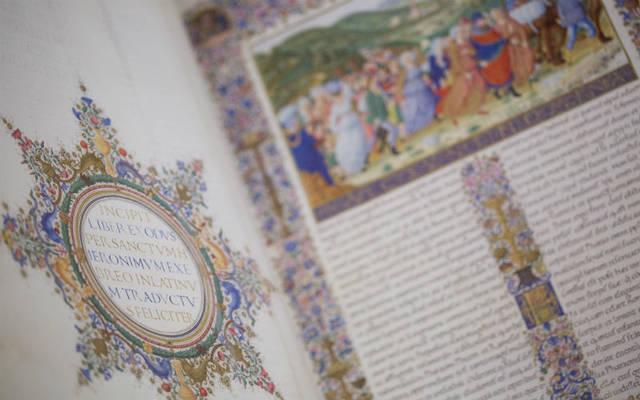 """<p>The first volume of the 15th-century Urbino Bible is seen inside the """"Vatican Museums and Vatican Library"""" exhibit at the Museum of the Bible in Washington Nov. 15.  </p>"""