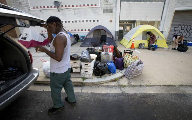 """<p> Homeless people are seen in Washington June 22. Bishop Frank J. Dewane of Venice, Fla., chair of the U.S. bishops' domestic policy committee, released a statement Nov. 17 proclaiming that the House of Representatives """"ignored impacts to the poor and families"""" in passing the Tax Cuts and Jobs Act the previous day. </p>"""