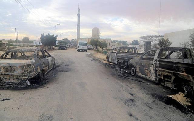 <p>Damaged vehicles are seen Nov. 25 after a bomb attack at Al-Rawdah Mosque in Bir al-Abd, Egypt.  </p>