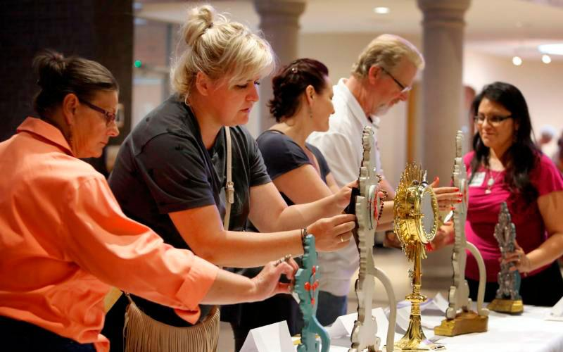 Worshippers venerate the relics of St. Padre Pio at St. Francis Borgia Church in Chicago Sept. 25, 2017. The veneration of relics is a fundamentally biblical practice. (CNS photo/Karen Callaway/Chicago Catholic)