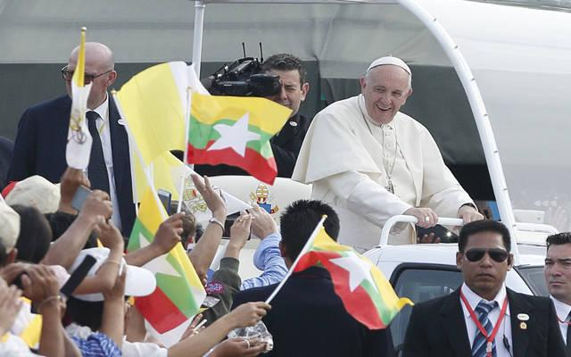 <p>Pope Francis greets the crowd as he arrives to celebrate Mass at Kyaikkasan sports ground in Yangon, Myanmar, Nov. 29.  </p>