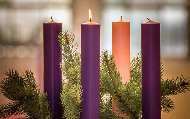 <p>A lit candle is seen on an Advent wreath in this 2016 photo. We remember that God&rsquo;s first miracle, light, is also his most frequent.  </p>