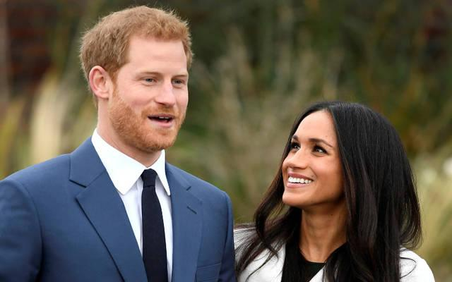 <p>Britain's Prince Harry poses with Meghan Markle Nov. 27 in the Sunken Garden of Kensington Palace in London after announcing their engagement. Markle attended Immaculate Heart High School in Los Angeles.  </p>