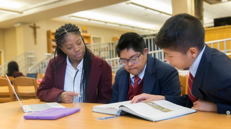 Raymond Tetschner, center, studies with some of his fellow students in 2018 at Bishop McNamara High School in Forestville, Md. (CNS photo by Jaclyn Lippelmann/Catholic Standard)