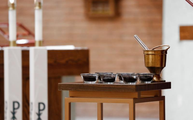Ashes are set out for Ash Wednesday Mass. Ashes are the gate into the Lenten pathway. It's not to teach us about death -- we know that already -- but about love that is stronger than death. (CNS photo by Nancy Wiechec)