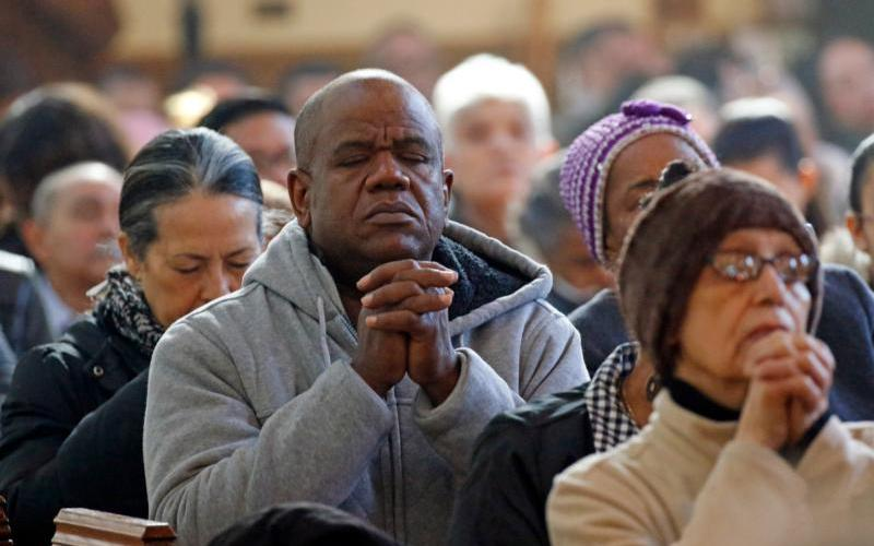 People pray during a Spanish-language Mass at St. John-Visitation Church in the Bronx, N.Y., March 24, 2019. (CNS photo by Gregory A. Shemitz)