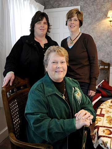 Gretchen Hubbard (bottom), poses with her two daughters, Stephanie Manciocchi (left) and Suzanne Luckenbach. The 2008 death of Manciocchi's son, Logan, prompted Hubbard to return to the Catholic Church.