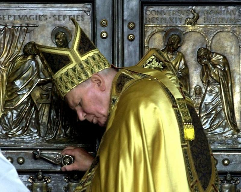 Pope John Paul II closes the Holy Door in St. Peter's Basilica at the Vatican in this Jan. 6, 2001, file photo.