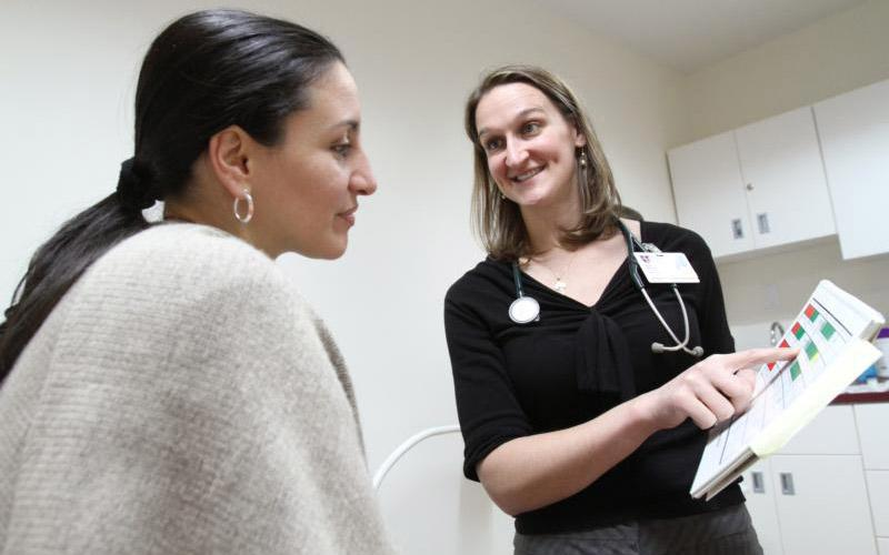 Dr. Anne Nolte, right, a family physician with the National Gianna Center for Women's Health and Fertility in New York, is pictured with a patient in 2009.