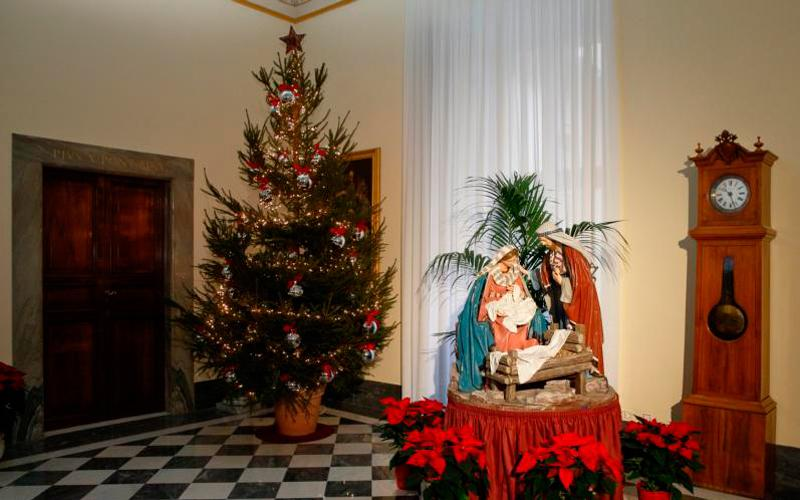 A Nativity scene and a Christmas tree are seen in the Apostolic Palace at the Vatican Dec. 7. (CNS photo by Paul Haring)
