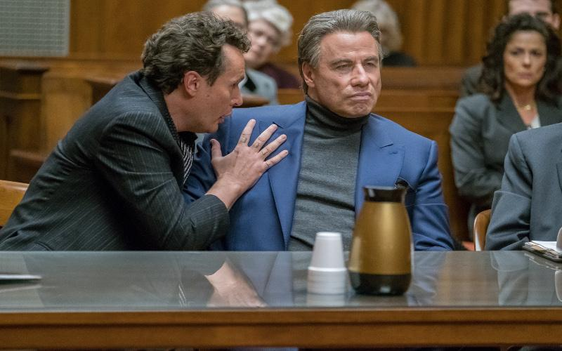 """John Travolta stars in a scene from the movie """"Gotti."""" The Catholic News Service classification is A-III -- adults. The Motion Picture Association of America rating is R -- restricted. Under 17 requires accompanying parent or adult guardian."""