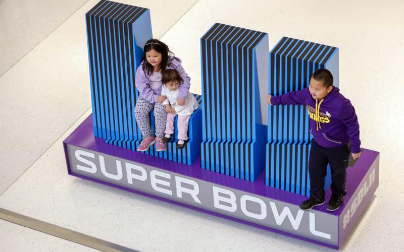 Children pose on a giant Super Bowl logo Jan. 28 at the media center in Bloomington, Minn. The NFC champions, the Philadelphia Eagles, and the AFC champions, the New England Patriots, will compete in Super Bowl LII Feb. 4 at U.S. Bank Stadium in Minneapolis. (CNS photo by Erik S. Lesser/EPA)