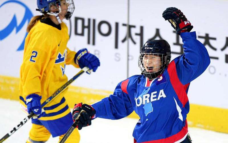 Park Jong-ah of the Korean unified women's ice hockey team celebrates after scoring a goal during a friendly match against Sweden Feb. 4 in Incheon, South Korea. The presence of a unified delegation and team for North and South Korea at this year's Olympic Games gives people hope for a world dedicated to peace through dialogue and respect, Pope Francis said. (CNS photo by Yonhap/EPA)