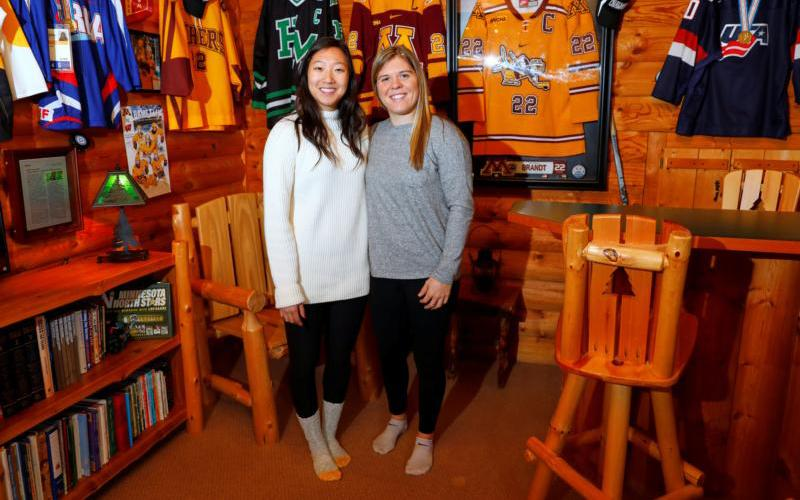 Hannah Brandt poses with her adopted sister Marissa, left, on Christmas day in 2017 at the family home in St. Paul, Minn. The Catholic siblings participated in the 2018 Winter Olympics on separate ice hockey teams. Hannah Brandt played for the U.S. and Marissa Brandt for the combined Koreas. (CNS photo by Adam Bettcher/Reuters)