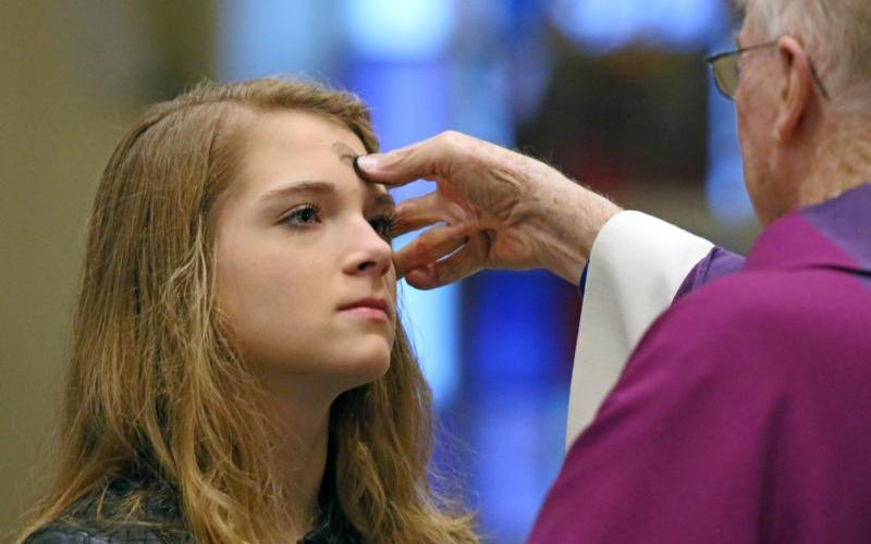 A woman receives ashes during an Ash Wednesday Mass Feb. 14 at St. James Church in Setauket, N.Y. (CNS photo by Gregory A. Shemitz)
