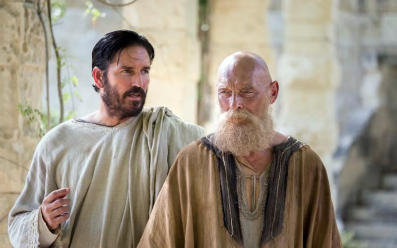 """Jim Caviezel as Luke and James Faulkner as Paul are seen in the film """"Paul, Apostle of Christ."""" """"His message of love and life and mercy is so important for us today,"""" said Eric Groth, one of the executive producers of the new movie. He spoke to an invitation-only audience of about 60 at a Feb. 15 advance screening of the film at St. John Paul II National Shrine in Washington. (CNS photo by Sony Pictures)"""
