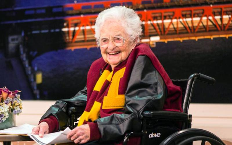 """Sister Jean Dolores Schmidt, 98, longtime chaplain of the Loyola University Chicago men's basketball team and campus icon, smiles during an appearance on """"Windy City Live"""" March 12 to discuss her bracket and the team's NCCA tournament run. (CNS photo courtesy Loyola University Chicago)"""