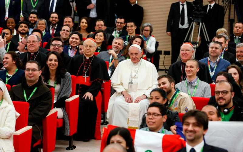 Pope Francis poses for a photo at a pre-synod gathering of youth delegates at the Pontifical International Maria Mater Ecclesiae College in Rome March 19. The meeting was in preparation for the Synod of Bishops on young people, the faith and vocational discernment this October at the Vatican. (CNS photo by Paul Haring)