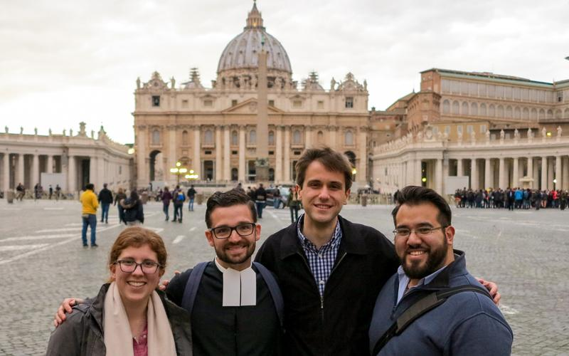 Katie Prejean-McGrady, De La Salle Christian Brother Javier Hansen, Chris Russo and Nick Lopez, some of the young adults from the United States participating in the Vatican's pre-synod meeting, posed March 21 in front of St. Peter's Square. (CNS photo by Robert Duncan)