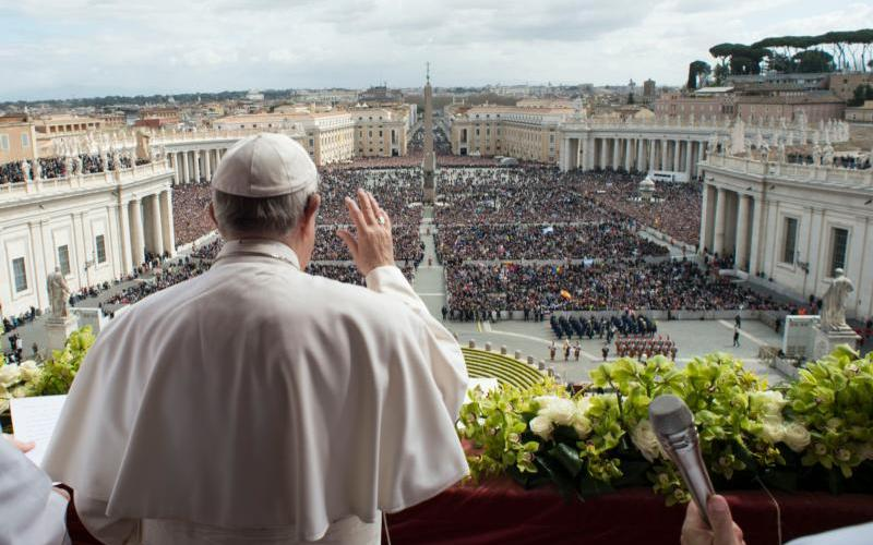 Pope Francis greets the crowd during his 2018 Easter message. (CNS photo by Vatican Media)