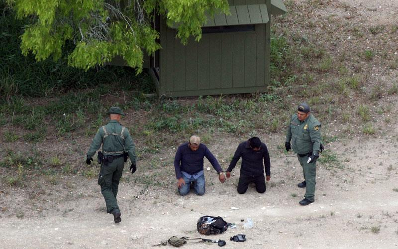 Border Patrol agents apprehend people who illegally crossed the border from Mexico into the U.S. in the Rio Grande Valley sector, near Falfurrias, Texas. U.S. President Donald Trump officially signed a memorandum April 4 to deploy the National Guard to the southwest border. (CNS photo by Loren Elliott/Reuters)