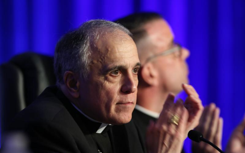 Cardinal Daniel N. DiNardo of Galveston-Houston, president of the U.S. Conference of Catholic Bishops, applauds June 13 at the opening of the bishops' annual spring assembly in Fort Lauderdale, Fla. (CNS photo by Bob Roller)