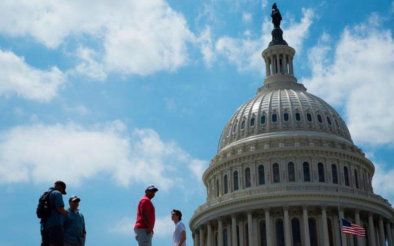 People are seen near the U.S. Capitol in Washington May 21. (CNS photo by Tyler Orsburn)
