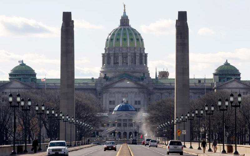The Pennsylvania statehouse is seen from the State Street bridge in Harrisburg. The Pennsylvania attorney general released a grand jury report Aug. 14 on a months-long investigation into abuse claims spanning a 70-year period in the Dioceses of Harrisburg, Pittsburgh, Scranton, Allentown, Greensburg and Erie. (CNS photo by Tim Shaffer/Reuters)