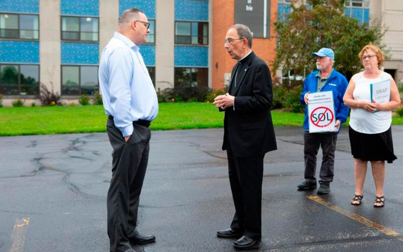 Bishop Lawrence T. Persico of Erie, Pa., speaks with Jim VanSickle of Pittsburgh, who told a Pennsylvania grand jury he was molested by a priest when he was a teenager in Bradford, Pa. The two men talked during an Aug. 21 news conference held in front of the Diocese of Erie's headquarters by members of the Survivors Network of those Abused by Priests, or SNAP. (CNS photo by Chaz Muth)