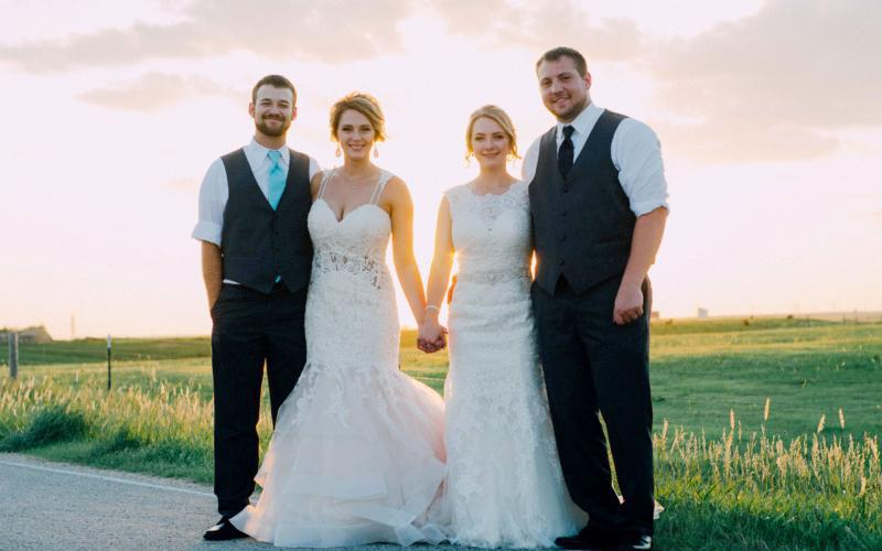 Twin sisters Amber and Brianna Wooldridge celebrated a double wedding July 7 at St. Francis of Assisi Church in Munjor, Kan. From left are Clay and Brianna Kear and Amber and Zach Binder. The fraternal twins served as the witness for one another during their vows. (CNS photo by Emily Garcia Photography)