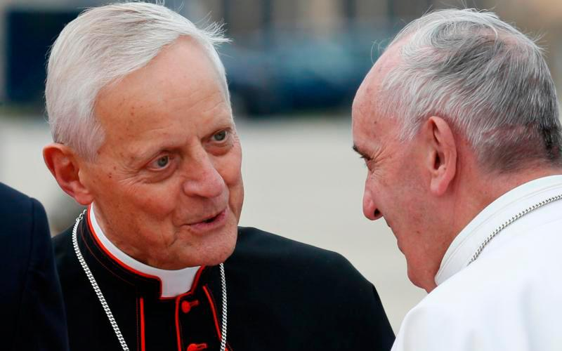 Cardinal Donald W. Wuerl of Washington talks with Pope Francis at Andrews Air Force Base in Maryland near Washington Sept. 22, 2015. Cardinal Wuerl announced Sept. 11 that he will meet soon with the pope to discuss the resignation he submitted three years ago when he turned 75. (CNS photo by Paul Haring)