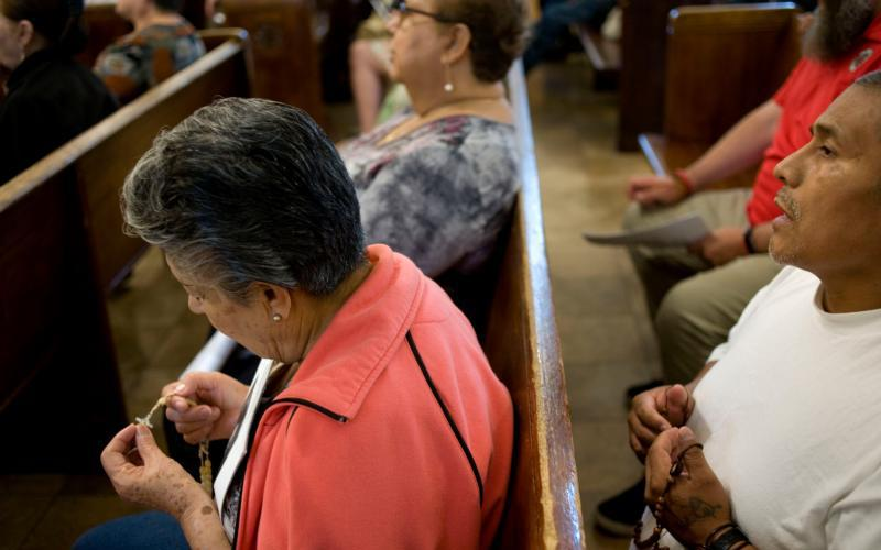 10.01.2018  Worshippers pray the rosary during a prayer service Sept. 7 at Dolores Mission Church in Los Angeles. (CNS photo by David Maung)