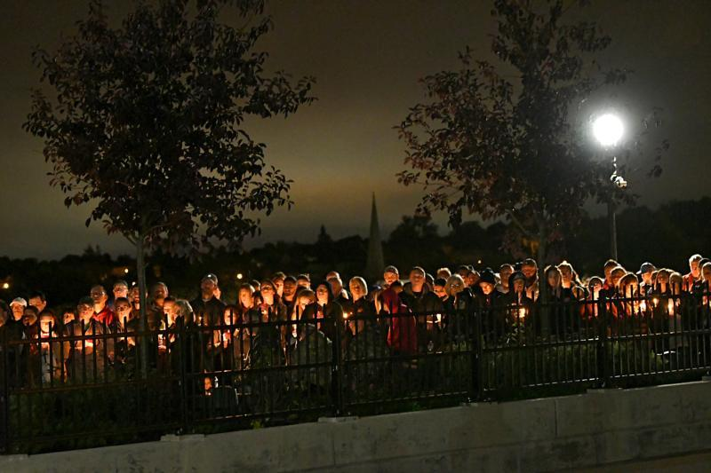 People on a bridge take part in a candlelight vigil Oct. 8 in Amsterdam, N.Y., for the victims of the limousine crash in Schoharie. The driver, Scott Lisincchia, 53, died in the Oct. 6 accident along with the 17 others inside the limousine and two pedestrians. It is the deadliest road accident in the United States in more than 13 years. (CNS photo by Lori Van Buren/Times Union)