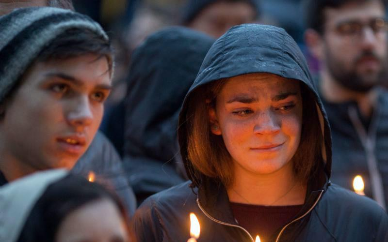 People mourn during a candlelight vigil Oct. 27 for victims of the shooting that killed eleven people at the Tree of Life Synagogue in Pittsburgh. Robert Bowers opened fire that morning during a service at the synagogue, also wounding at least six others, including four police officers, authorities said. (CNS photo by John Altdorfer/Reuters)