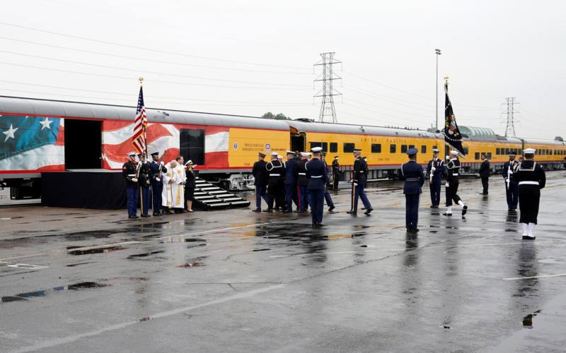 The flag-draped casket of former President George H.W. Bush is carried Dec. 6 to a Union Pacific train by a military honor guard. (CNS photo by David J. Phillip, pool via Reuters)