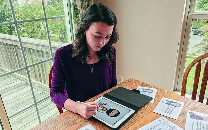 Rebecca Pohlmeier of Dumfries, Va., draws an illustration of St. Juan Diego on her iPad Oct. 26. The 16-year-old started her illustrated saints' business, Glory Be Prints, to pay for a trip with a volunteer service camp. (CNS photo by Melissa Pohlmeier/Catholic Herald)