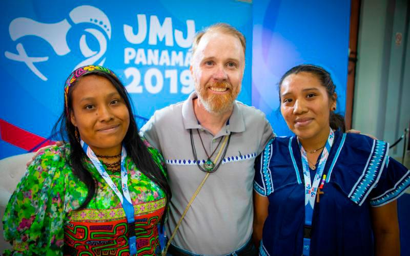 Indigenous World Youth Day pilgrims Edigibali Lopez, 24, of Guna Yala, Panama, and Enith Sanchez, 23, of Ngabe Bugle, pose for a photo with Vincentian Father Joseph Fitzgerald, executive secretary of Indigenous Ministry of the Panamanian bishops' conference, in Panama City Jan. 22, 2019. (CNS photo by Chaz Muth)