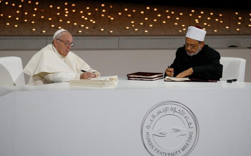 Pope Francis and Sheik Ahmad el-Tayeb, grand imam of Egypt's al-Azhar mosque and university, sign documents during an interreligious meeting at the Founder's Memorial in Abu Dhabi, United Arab Emirates, Feb. 4, 2019. (CNS photo by Paul Haring)