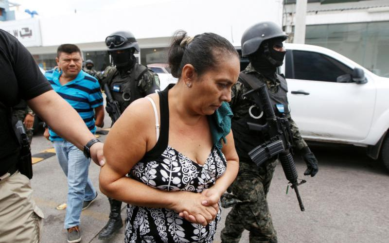 Investigative police agents escort suspected members of a human trafficking ring as they arrive to a court hearing in Tegucigalpa, Honduras, June 9, 2016. (CNS photo by Jorge Cabrera/ Reuters)