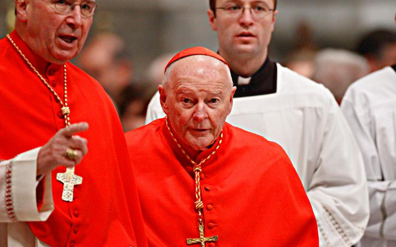 Former cardinal Theodore E. McCarrick (center) is shown arriving for a Mass with Pope Benedict XVI in St. Peter's Basilica on Nov. 21, 2010. (CNS photo by Paul Haring)