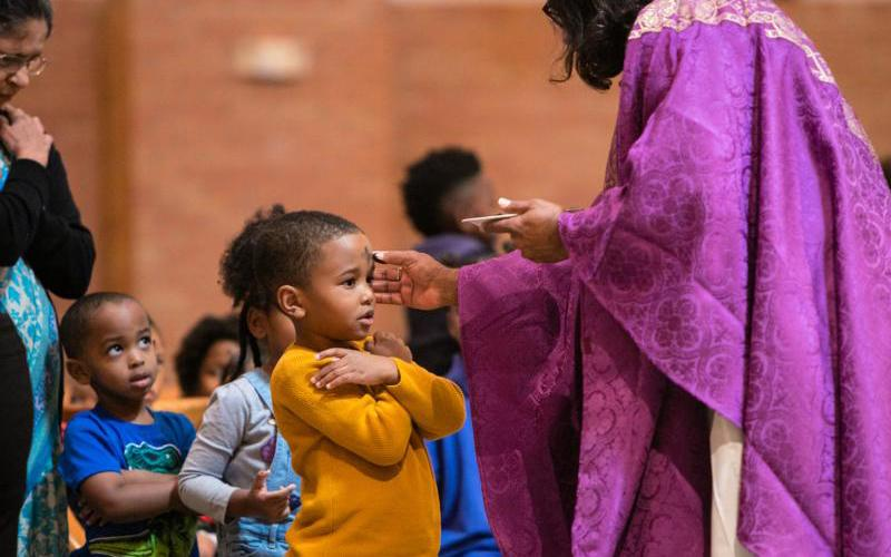 A student at St. Mary of the Purification Catholic Montessori School in Houston, Texas receives ashes March 6, 2019. (CNS photo by James Ramos/Texas Catholic Herald)