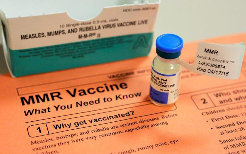 A vial of measles, mumps and rubella vaccine and an information sheet is seen at Boston Children's Hospital Feb. 26, 2015. (CNS photo by Brian Snyder/Reuters)