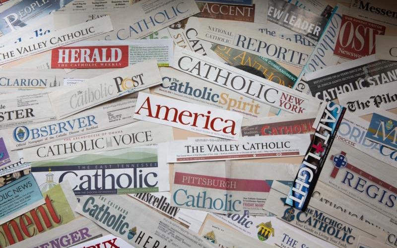 The mastheads of numerous Catholic newspapers are seen in this photo illustration. (CNS photo by Tyler Orsburn)