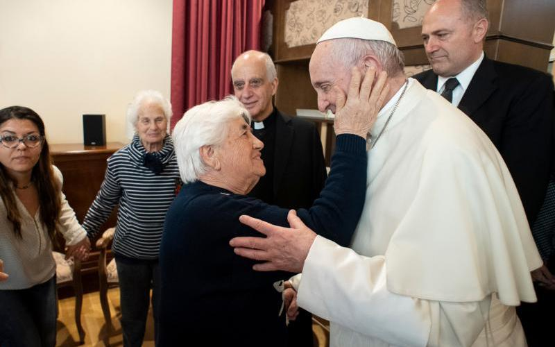 Pope Francis greets Emanuele Village residents April 12, 2019, in Rome. People who live there have Alzheimer's disease. (CNS photo by Vatican Media, handout via Reuters)