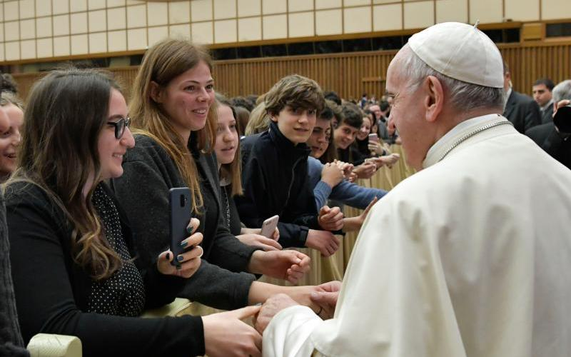 Pope Francis greets people during an audience with students and staff from Ennio Quirino Visconti Lyceum-Gymnasium, a school in Rome, at the Vatican April 13, 2019. (CNS photo by Vatican Media)
