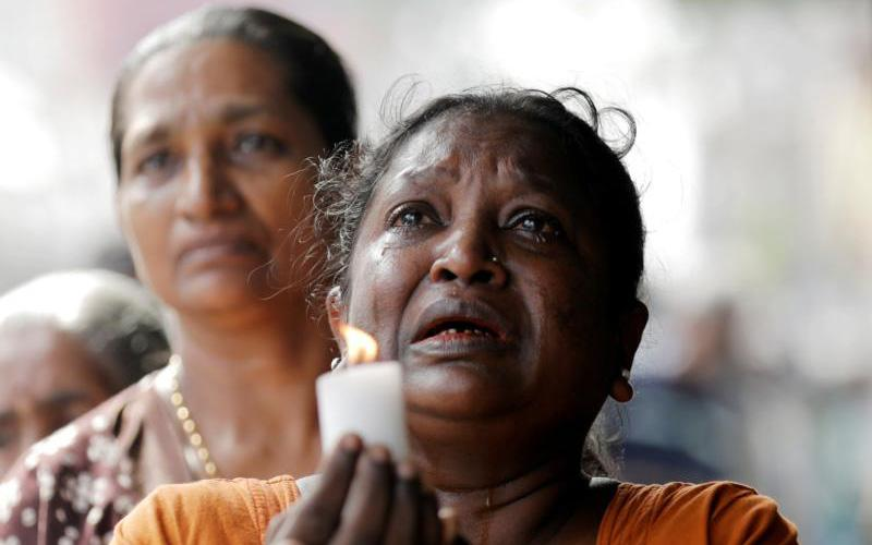 A woman weeps during a memorial service for victims in Colombo, Sri Lanka, April 23, 2019, two days after a string of suicide bomb attacks on churches and luxury hotels across the island. (CNS photo by Dinuka Liyanawatte/Reuters)