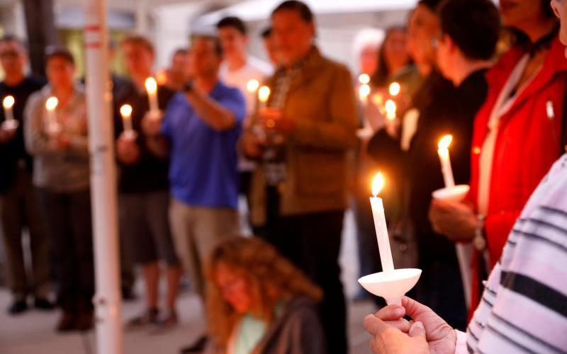 A candlelight vigil is held April 27, 2019, at Rancho Bernardo Community Presbyterian Church for victims of a shooting incident at the Congregation Chabad synagogue in Poway, Calif., near San Diego.  (CNS photo by John Gastaldo/Reuters)