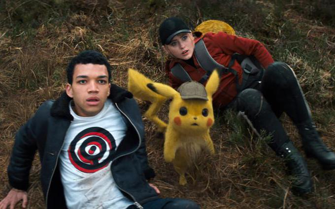 "Justice Smith, Detective Pikachu (voiced by Ryan Reynolds) and Katrhyn Newton appear in the movie ""Pokemon Detective Pikachu."" (CNS photo/Warner Bros."