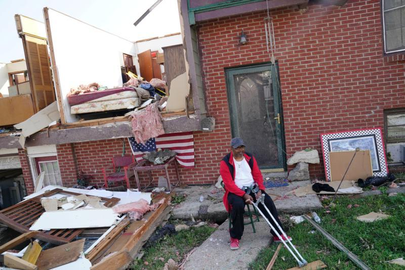 A man sits outside his destroyed home May 23, 2019, following a tornado in Jefferson City, Mo.  (CNS photo by Carlo Allegri/Reuters)