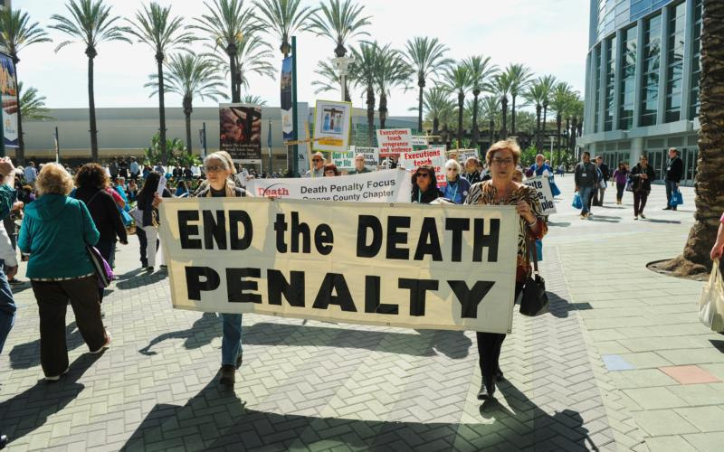 Demonstrators march through a courtyard to protest the death penalty during a rally in Anaheim Feb. 25, 2017.(CNS photo by Andrew Cullen/Reuters)